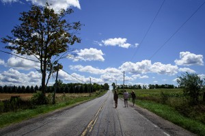 boys-running-away-conutry-road